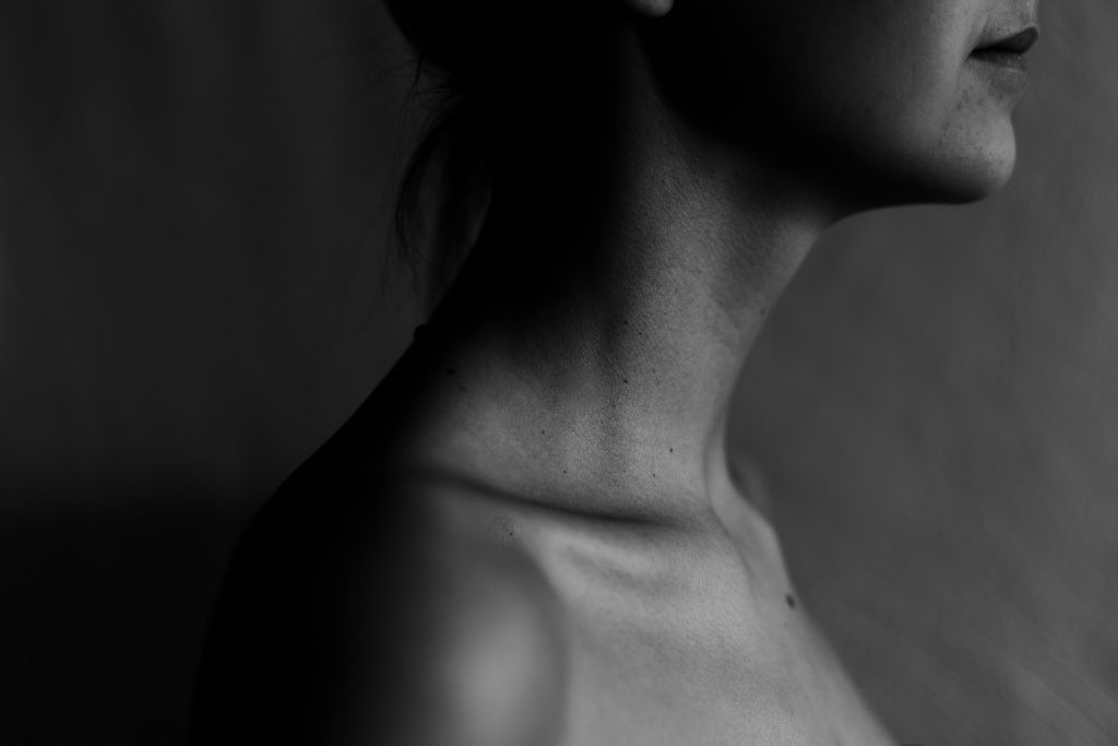 side profile of woman's neck